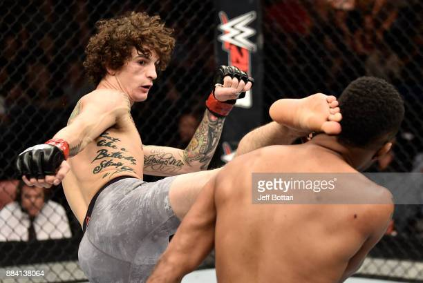 Sean O'Malley kicks Terrion Ware in their bantamweight bout during the TUF Finale event inside Park Theater on December 01 2017 in Las Vegas Nevada