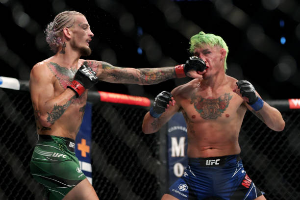 Sean O'Malley lands a punch on Kris Moutinho in the first round in their bantamweight bout during UFC 264: Poirier v McGregor 3 at T-Mobile Arena on...