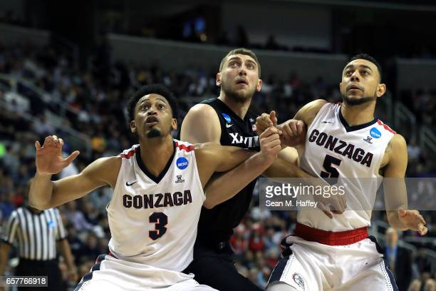 Sean O'Mara of the Xavier Musketeers is boxed out by Johnathan Williams and Nigel WilliamsGoss of the Gonzaga Bulldogs during the 2017 NCAA Men's...