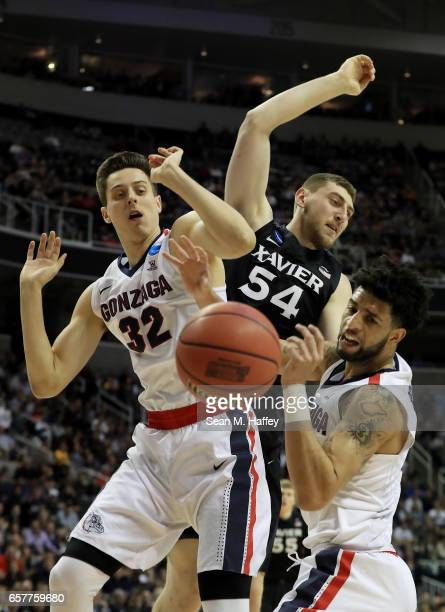 Sean O'Mara of the Xavier Musketeers vies for a rebound with Zach Collins and Josh Perkins of the Gonzaga Bulldogs in the first half during the 2017...