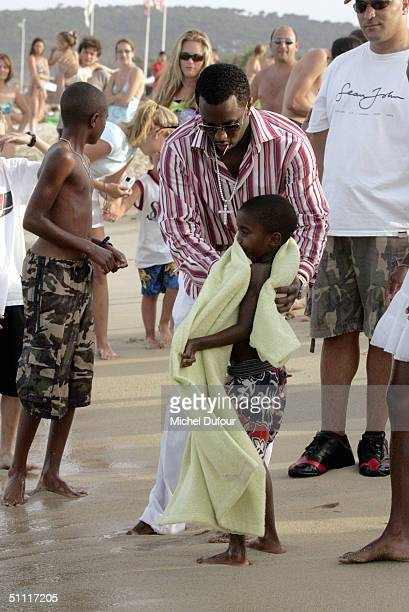 Sean 'P Diddy' Combs and his son are seen on Pampelonne Beach during lunch at Le Club 55 July 26 2004 in Saint Tropez France