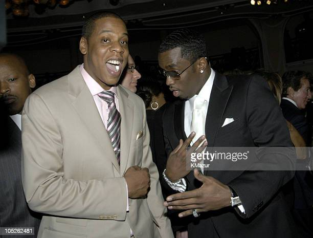 Sean P Diddy Combs and Jay Z during 2004 Clive Davis PreGrammy Party Backstage and Audience at Beverly Hills Hotel in Beverly Hills California United...