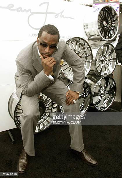 Sean 'P Diddy' Combs poses next to his line of Sean John Wheels made by Weld Wheels during the 2005 New York Auto Show at the Jacob Javits Convention...