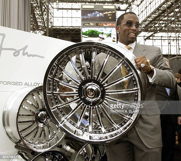 Sean 'P Diddy' Combs poses with his line of Sean John Wheels made by Weld Wheels during the 2005 New York Auto Show at the Jacob Javits Convention...