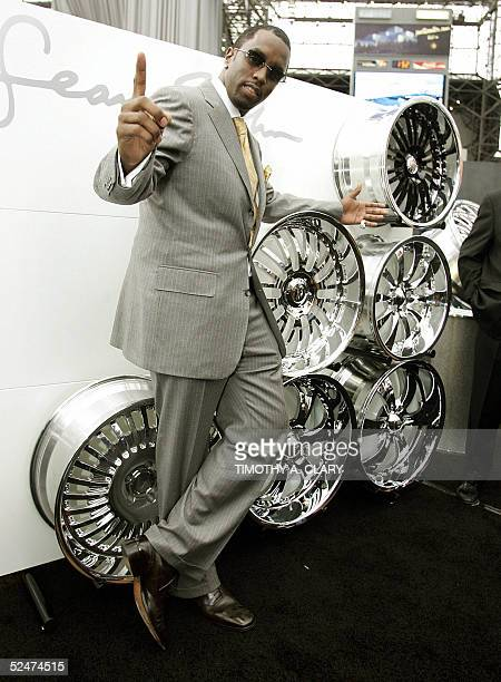 Sean 'P Diddy' Combs stands next to his line of Sean John Wheels made by Weld Wheels during the 2005 New York Auto Show at the Jacob Javits...