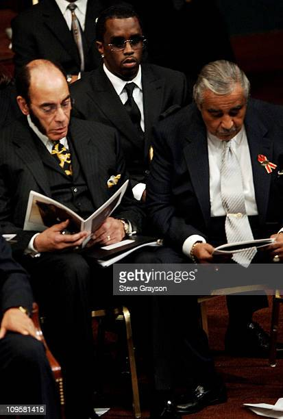 Sean P Diddy Combs with other dignitaries Earl Graves and Congressman Charles Rangel during the funeral service for Johnnie Cochran at the West...