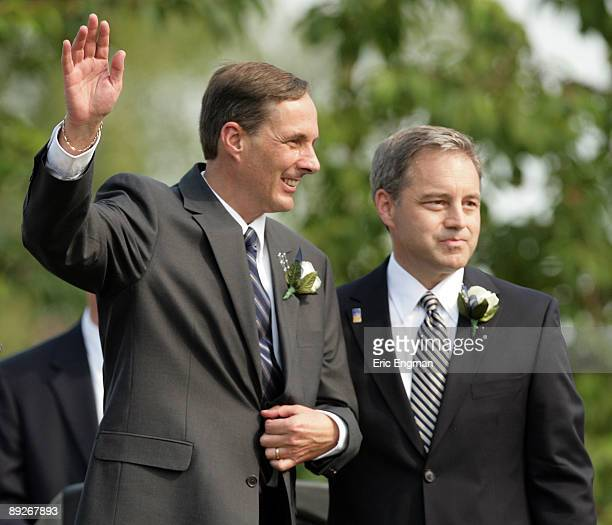 Sean Parnell the new Governor and Craig E Campbell new Lieutenant Governor wave to the crowd after being sworn in during the annual Governor's Picnic...