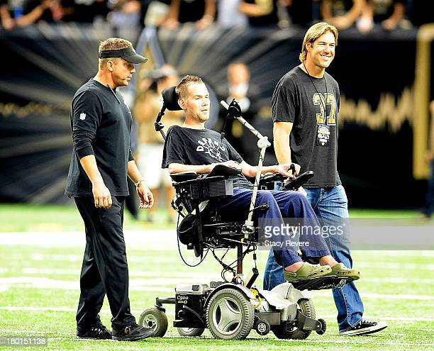 Sean Payton head coach of the New Orleans Saints takes the field with former players Steve Gleason and Scott Fujita prior to a game against the...