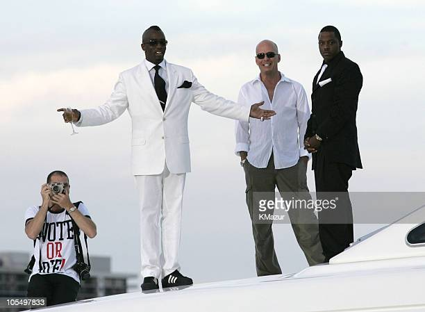 Sean 'PDiddy' Combs and Bruce Willis during 2004 MTV Video Music Awards Red Carpet at American Airlines Arena in Miami Florida United States