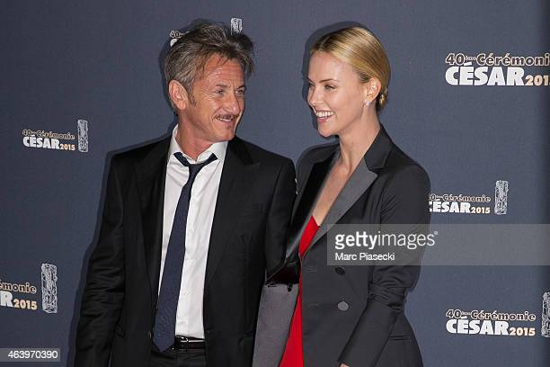 Sean Penn and Charlize Theron attend the 'CESARS' Film awards at Theatre du Chatelet on February 20, 2015 in Paris, France.