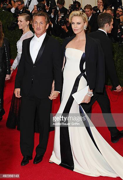 Sean Penn and Charlize Theron attend the 'Charles James: Beyond Fashion' Costume Institute Gala at the Metropolitan Museum of Art on May 5, 2014 in...