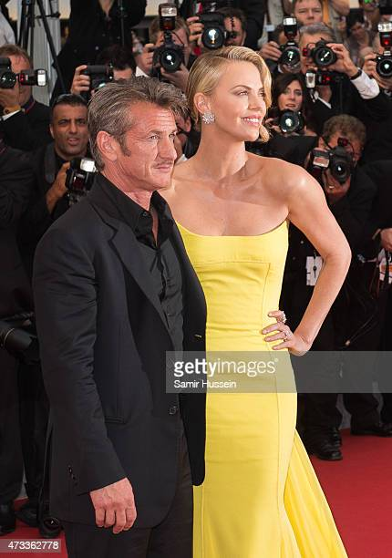 Sean Penn and Charlize Theron attend the Mad Max Fury Road Premiere during the 68th annual Cannes Film Festival on May 14 2015 in Cannes France