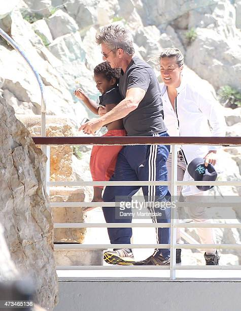 Sean Penn and Jackson Theron are seen at the Hotel du CapEdenRoc day 3 of the 68th annual Cannes Film Festival on May 15 2015 in Cannes France