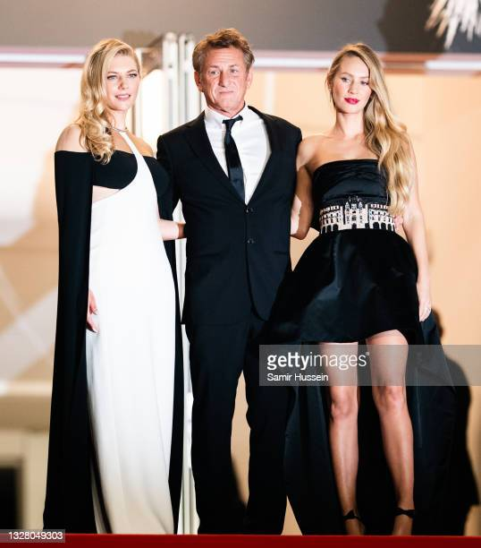 """Sean Penn, Dylan Penn Katheryn Winnick attend the """"Flag Day"""" photocall during the 74th annual Cannes Film Festival on July 11, 2021 in Cannes, France."""