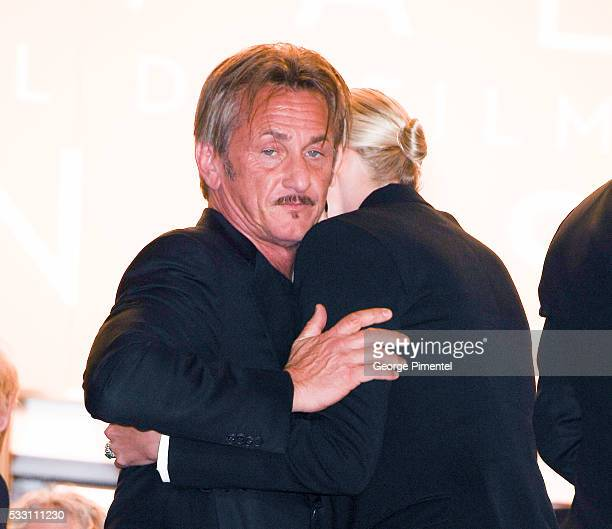 Sean Penn embraces Charlize Theron as they attend the screening of 'The Last Face' at the annual 69th Cannes Film Festival at Palais des Festivals on...