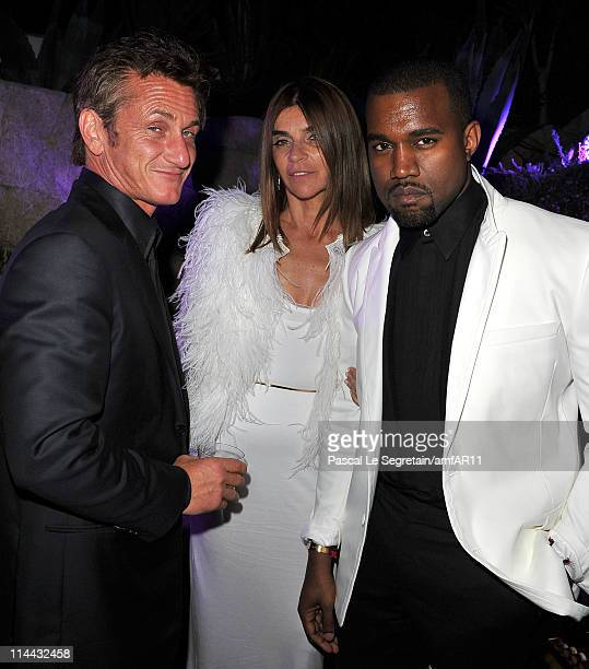 Sean Penn Former EditorinChief of French Vogue Carine Roitfeld and Kanye West attends amfAR's Cinema Against AIDS Gala after party during the 64th...