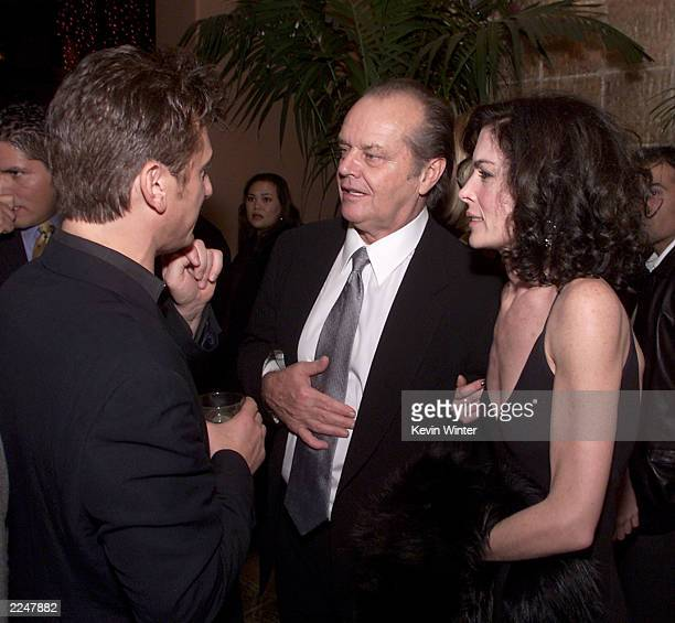 Sean Penn Jack Nicholson and Lara Flynn Boyle at the postpremiere party for 'The Pledge' at The Sunset Room in Los Angeles Ca 01/09/01