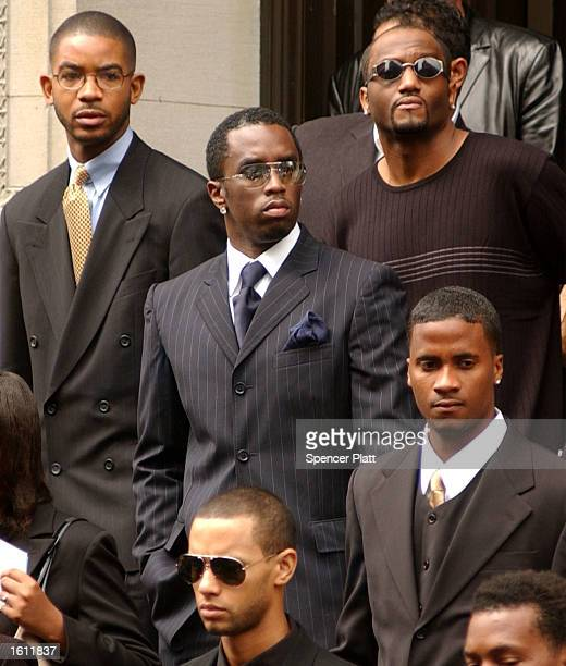 Sean Puffy Combs exits the funeral service for the late RB singer Aaliyah August 31 2001 at St Ignatius Loyola Church in New York City The 22yearold...