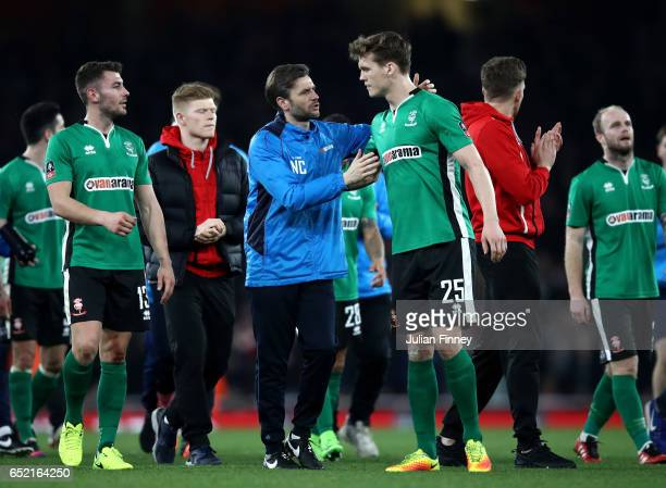 Sean Ragget speaks with anny Cowley manager of Lincoln City after defear in The Emirates FA Cup QuarterFinal match between Arsenal and Lincoln City...