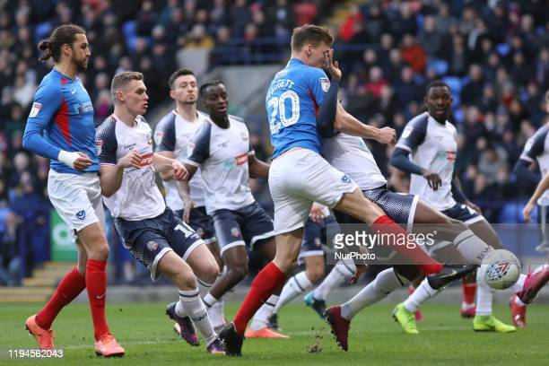 Sean Raggett of Portsmouth FC battles for the ball during the Sky Bet League 1 match between Bolton Wanderers and Portsmouth at the Reebok Stadium,...