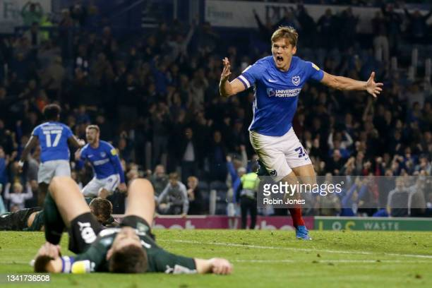 Sean Raggett of Portsmouth FC celebrates after scoring equaliser to make it 2-2 during the Sky Bet League One match between Portsmouth and Plymouth...