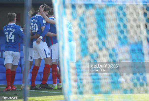 Sean Raggett of Portsmouth FC is congratulated after scoring the first goal during the Sky Bet League One match between Portsmouth and Gillingham at...