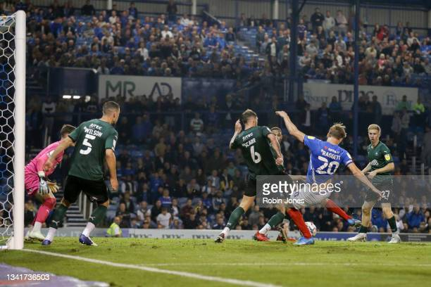 Sean Raggett of Portsmouth FC scores equaliser to make it 2-2 during the Sky Bet League One match between Portsmouth and Plymouth Argyle at Fratton...