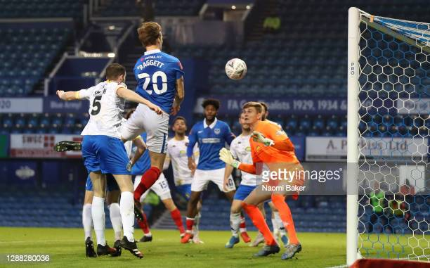 Sean Raggett of Portsmouth scores his team's third goal during the FA Cup Second Round match between Portsmouth FC and King's Lynn Town on November...