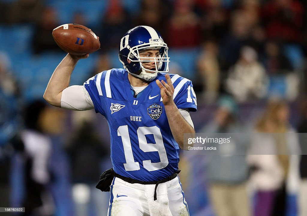 Sean Renfree #19 of the Duke Blue Devils drops back to pass against the Cincinnati Bearcats during their game at Bank of America Stadium on December 27, 2012 in Charlotte, North Carolina.