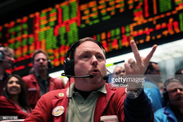 Sean Ridgeway signals an offer in the Eurodollar pit at the Chicago Mercantile Exchange following the announcement from the Federal Open Market...