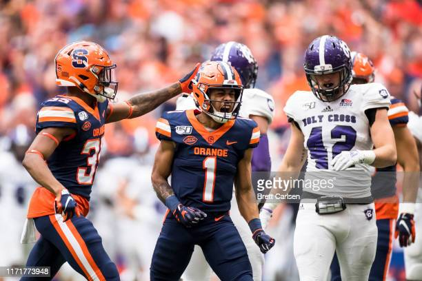 Sean Riley of the Syracuse Orange celebrates a punt return during the third quarter against the Holy Cross Crusaders at the Carrier Dome on September...