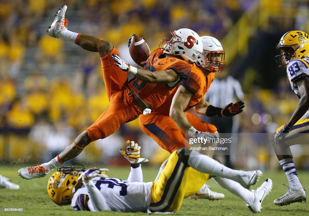Sean Riley #10 of the Syracuse Orange is tackled by Eric Monroe #30 of the LSU Tigers during the second half of a game at Tiger Stadium on September 23, 2017 in Baton Rouge, Louisiana.