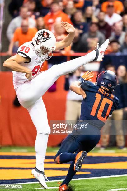 Sean Riley of the Syracuse Orange makes contact with AJ Cole III of the North Carolina State Wolfpack during the second quarter resulting in a...