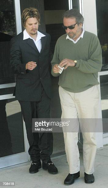 Sean Rodrick Stewart the son of musician Rod Stewart exits the Malibu Courthouse with an unidentified friend after appearing in court for a...