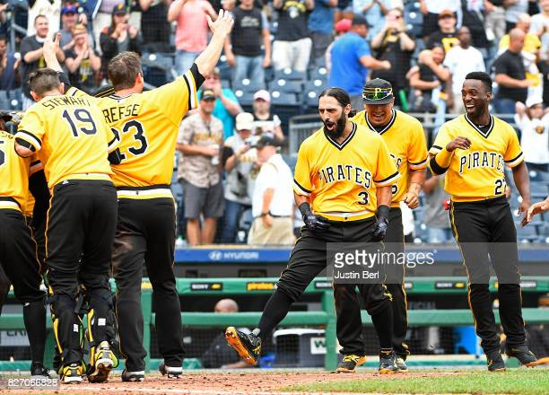 Sean Rodriguez of the Pittsburgh Pirates celebrates with teammates as he rounds the bases after hitting a walk off home run to give the Pittsburgh...