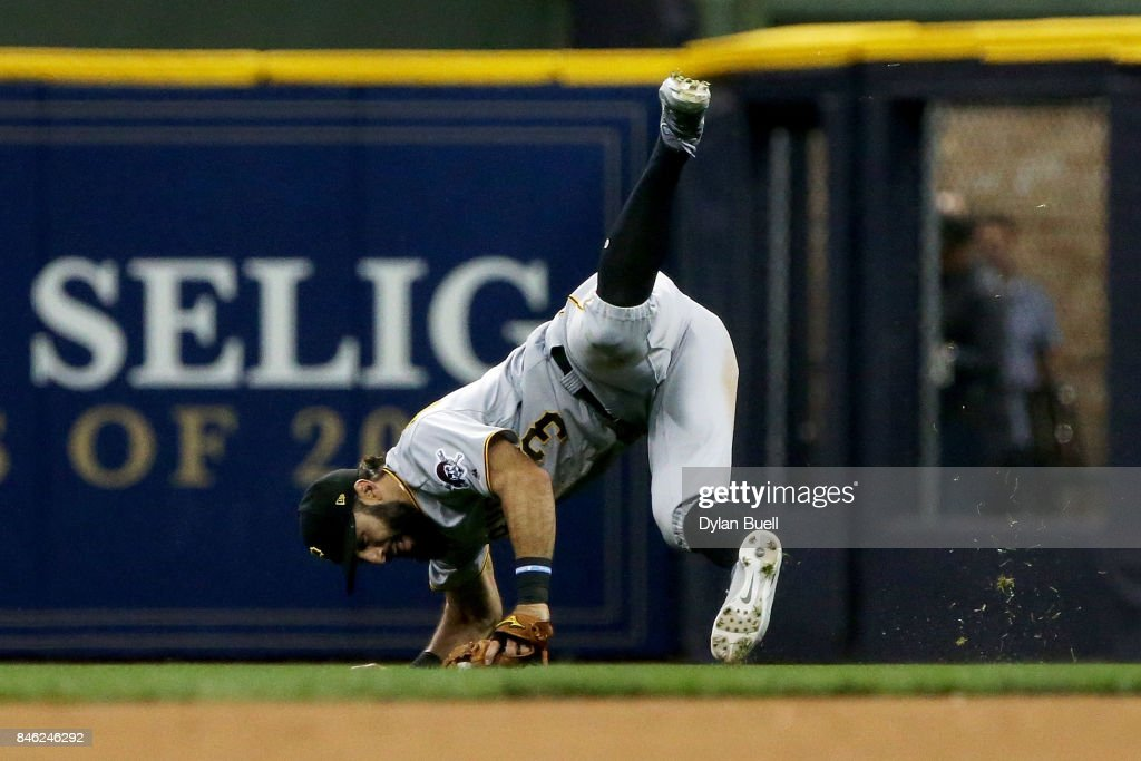 Sean Rodriguez #3 of the Pittsburgh Pirates dives after making a catch in the seventh inning against the Milwaukee Brewers at Miller Park on September 12, 2017 in Milwaukee, Wisconsin.