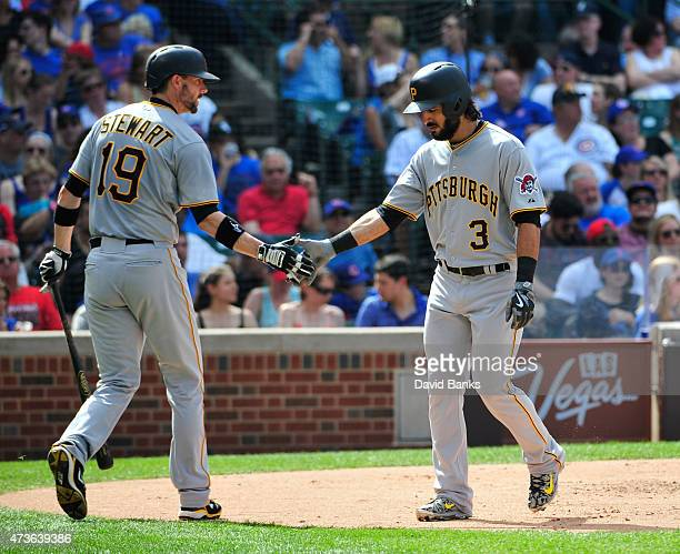 Sean Rodriguez of the Pittsburgh Pirates is greeted by Chris Stewart after hitting a home run against the Chicago Cubs during the third inning on May...