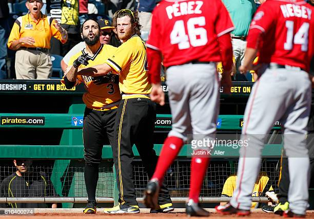 Sean Rodriguez of the Pittsburgh Pirates is held back by Gerrit Cole during a bench clearing altercation against the Washington Nationals at PNC Park...