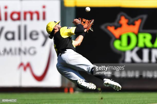 Sean Rodriguez of the Pittsburgh Pirates makes an over the shoulder catch of a fly ball in short center field during the eighth inning against the...
