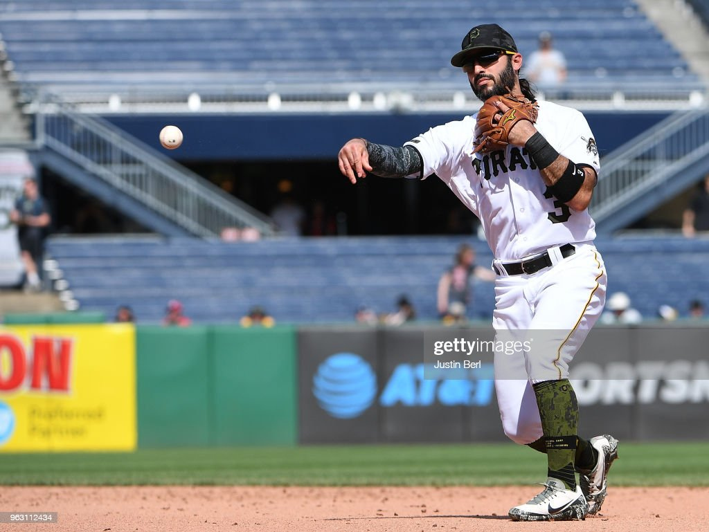 Sean Rodriguez #3 of the Pittsburgh Pirates throws to first base for a force out of Marcell Ozuna of the St. Louis Cardinals in the ninth inning during the game at PNC Park on May 27, 2018 in Pittsburgh, Pennsylvania.