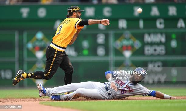 Sean Rodriguez of the Pittsburgh Pirates turns a double play against Austin Jackson of the New York Mets in the fifth inning during the game at PNC...