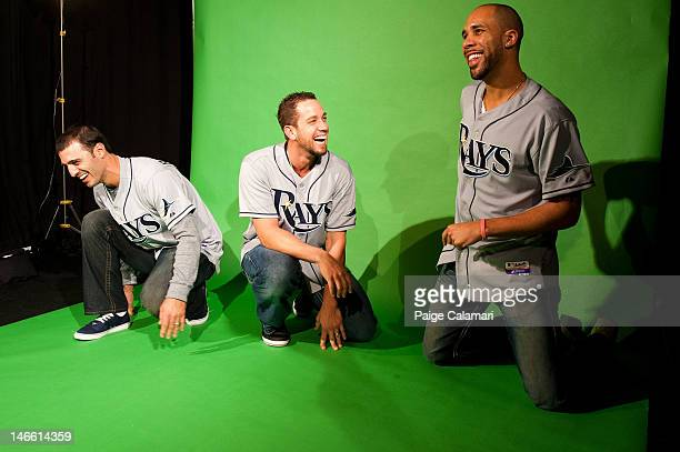 Sean Rodriguez of the Tampa Bay Rays pulls a prank on teammates James Shields and David Price after their visit at the MLB Fan Cave Wednesday May 9...