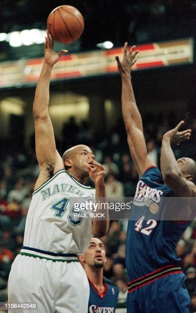 Sean Rooks of the Dallas Mavericks shoots a hook shot over Theo Ratliff of the Philadelphia 76ers in the first half of play at Reunion Arena in...