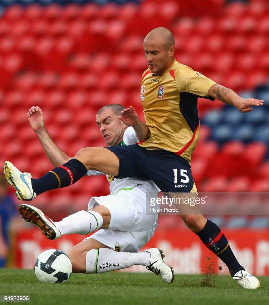 Sean Rooney of the Jets is tackled by Grant Smith of the Fury during the round 20 A-League match between the Newcastle Jets and the North Queensland...