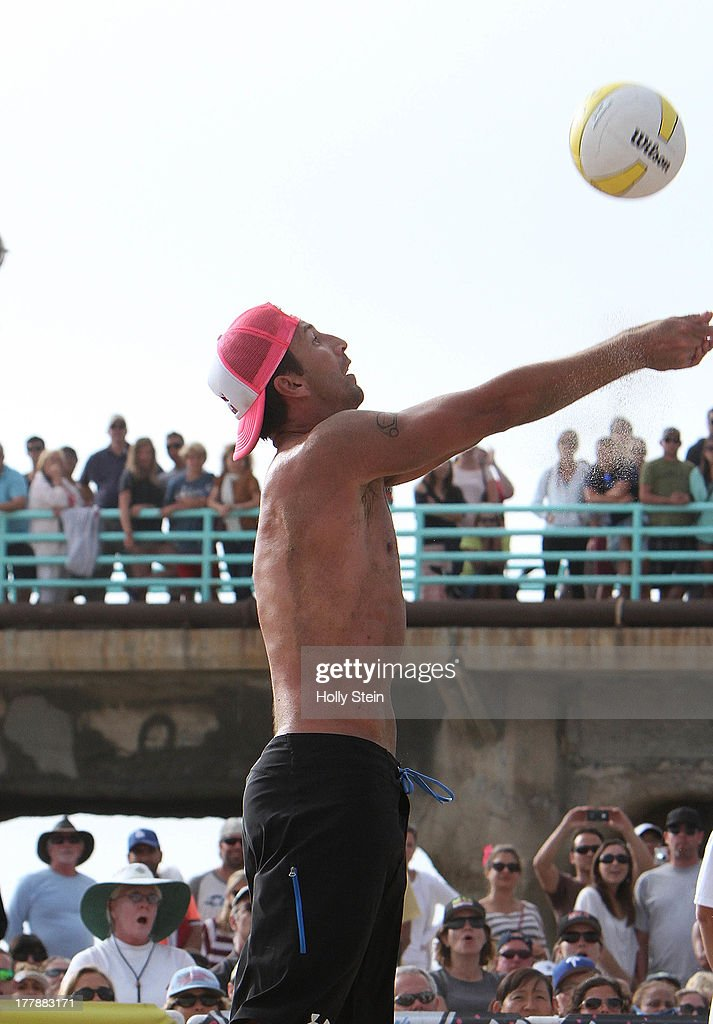 Sean Rosenthal digs the ball during the men's finals at the AVP Manhattan Beach Open on August 25, 2013 in Manhattan Beach, California. Rosenthal and his partner Phil Dalhausser lost to Casey Jennings and Matt Fuerbringer 21-18, 21-23, 15-12.