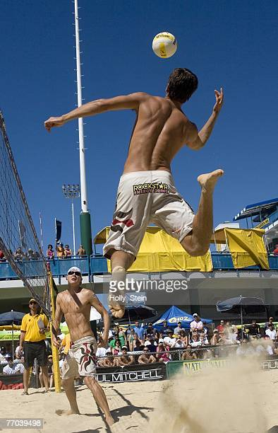 Sean Rosenthal hits the ball while partner Jake Gibb watches during the men's main draw against Stein Metzger and Mike Lambert in the AVP Pringles...