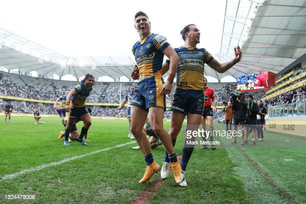 Sean Russell of the Eels celebrates scoring a try with team mate Clinton Gutherson of the Eels during the round 15 NRL match between the Parramatta...