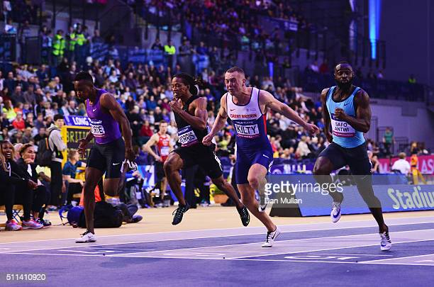 Sean Safo-Antwi of Great Britain crosses the line to win the Men's 60 metres final ahead of Richard Kilty of Great Britain , Joseph Morris of the...