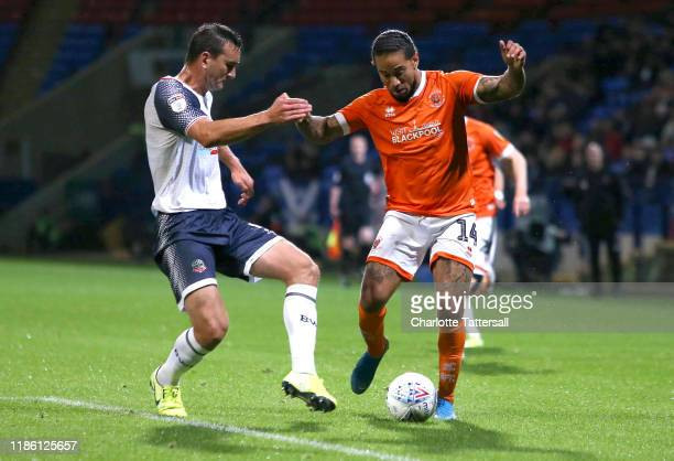 Sean Scannell of Blackpool FC is challenged by Jack Hobbs of Bolton Wanderers during the Sky Bet Leauge One match between Bolton Wanderers and...