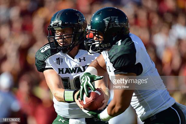 Sean Schroeder of the Hawaii Warriors hands off to Joey Iosefa during the first quarter against the USC Trojans at Los Angeles Coliseum on September...